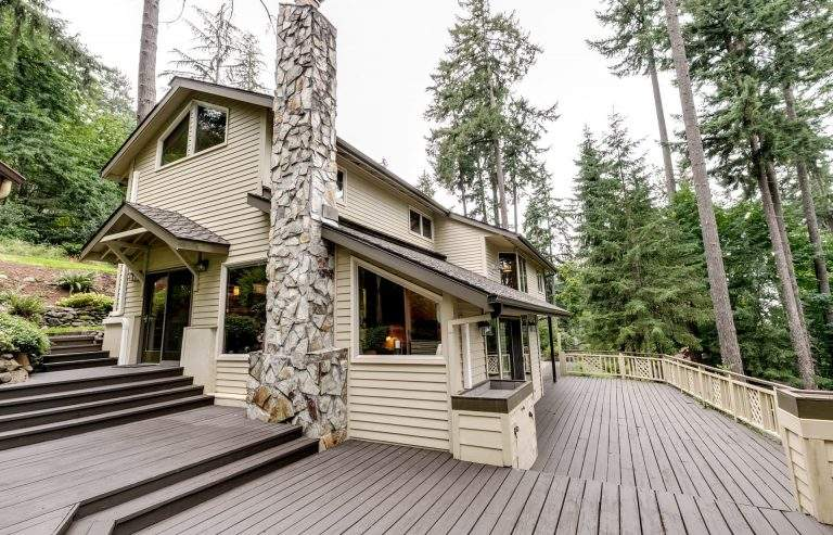 Churchill neigborhood Eugene modern home with impressive decking and stone chimney