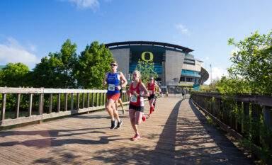 Marathon runners in front of Autzen Stadium in Eugene