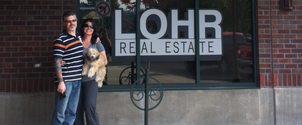 Kip and Megan Lohr Bend, Oregon Realtors standing outside office
