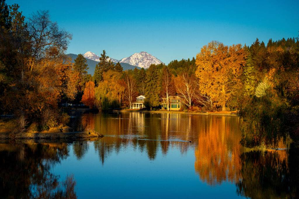Mirror Pond in the autumn with view of Cascades Mountains, Bend OR