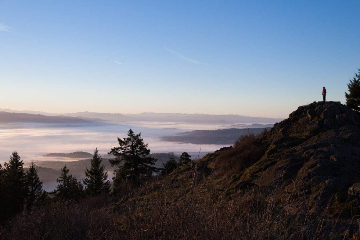 Woman standing on top of Spencer's Butte near Eugene, Oregon