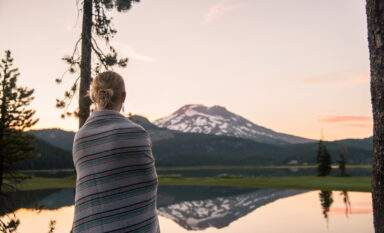 Woman in blanket at Sparks Lake in Oregon
